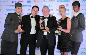 Peter Baumgartner, Chief Commercial Officer, Etihad Airways (centre left); Graham E. Cooke, World Travel Awards President & Founder (centre); Aubrey Tiedt, Vice President Guest Services, Etihad Airways (centre right) celebrate Etihad Airways' success at the World Travel Awards Middle East.