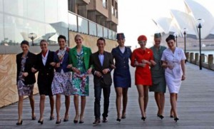 Martin Grant with a line-up of 50 years of Qantas uniforms