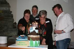 Pictured here with the Dart River Jet Cake are [L-R] founders Robyn Ross and Neil Ross, Lorraine Lindsay & Dart River Jet General Manager Clark Scott.